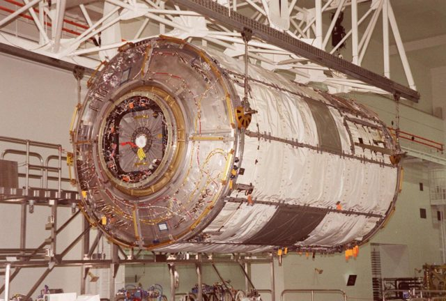 KENNEDY SPACE CENTER, FLA. -- This closeup shows the U.S. Lab Destiny being lifted by an overhead crane to move it to a weigh stand. A component of the International Space Station, Destiny is scheduled to fly on mission STS-98 in early 2001. During the mission, the crew will install the Lab during a series of three space walks. The STS-98 mission will provide the station with science research facilities and expand its power, life support and control capabilities. The U.S. Lab module continues a long tradition of microgravity materials research, first conducted by Skylab and later Shuttle and Spacelab missions. Destiny is expected to be a major feature in future research, providing facilities for biotechnology, fluid physics, combustion, and life sciences research KSC-00pp0800