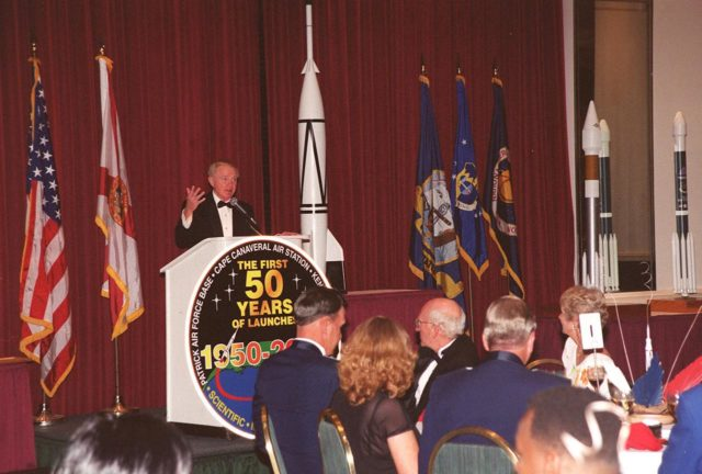 Center Director Roy Bridges addresses attendees at a 50<sup>th</sup> anniversary gala capping a year-long celebration of 50 years of launches from Cape Canaveral Air Force Station. Among those at the head table directly in front of the podium are Commander of the 45<sup>th</sup> Space Wing Brig. Gen. Donald Pettit and Gala Committee Chairman Ed Gormel. The first launch at CCAFS took place at 9:28 a.m. on July 24, 1950, with the liftoff of Bumper 8 from Launch Complex 3 KSC-00pp0925