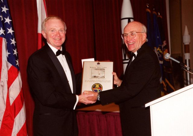 At a 50th anniversary gala capping a year-long celebration of 50 years of launches from Cape Canaveral Air Force Station, Center Director Roy Bridges (left) receives a plaque from committee chairman Ed Gormel. The plaque has a photo of the first rocket launch from Cape Canaveral Air Force Station (CCAFSj) and an anniversary patch below it that was flown on STS-99. The first launch at CCAFS took place at 9:28 a.m. on July 24, 1950, with the liftoff of Bumper 8 from Launch Complex 3. The gala, hosted by the Cape Canaveral Chapter Air Force Association, featured such speakers as Center Director Roy Bridges; Vice Commander, Air Force Space Command, Lt. Gen. Roger DeKok; and the Honorable David Weldon, U.S. representative of Florida's 15th Congressional District KSC-00pp0926