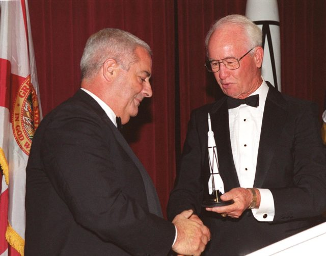 At a 50<sup>th</sup> anniversary gala capping a year-long celebration of 50 years of rocket launches from Cape Canaveral Air Force Station, Chris Bailey (left), president of the AFA Cape Canaveral Chapter, receives a rocket model from Maxwell King (right), former president of Brevard Community College. The first launch at CCAFS took place at 9:28 a.m. on July 24, 1950, with the liftoff of Bumper 8 from Launch Complex 3. The gala, hosted by the Cape Canaveral Chapter Air Force Association, featured such speakers as Center Director Roy Bridges; Vice Commander, Air Force Space Command, Lt. Gen. Roger DeKok; and the Honorable David Weldon, U.S. representative of Florida's 15<sup>th</sup> Congressional District KSC-00pp0927
