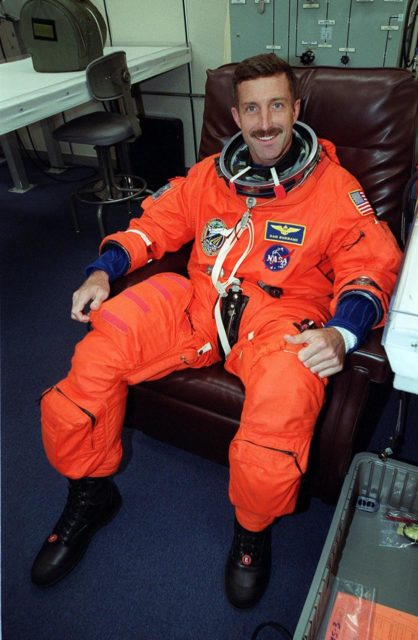 """During suitup in the Operations and Checkout Building, STS-106 Mission Specialist Daniel C. Burbank smiles in anticipation of launch. This is Burbank's first space flight. Space Shuttle Atlantis is set to lift off 8:45 a.m. EDT on the fourth flight to the International Space Station. During the 11-day mission, the seven-member crew will perform support tasks on orbit, transfer supplies and prepare the living quarters in the newly arrived Zvezda Service Module. The first long-duration crew, dubbed """"Expedition One,"""" is due to arrive at the Station in late fall KSC-00pp1259"""