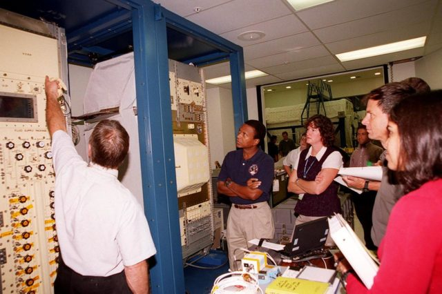 KENNEDY SPACE CENTER, FLA. -- Members of the STS-107 crew check out equipment at SPACEHAB. Beginning in the center are Mission Specialists Michael Anderson and Laurel Clark; at far right are Ilan Ramon, from Israel, and Kalpana Chawla. Identified as a research mission, STS-107 is scheduled for launch July 19, 2001 KSC-00pp1591