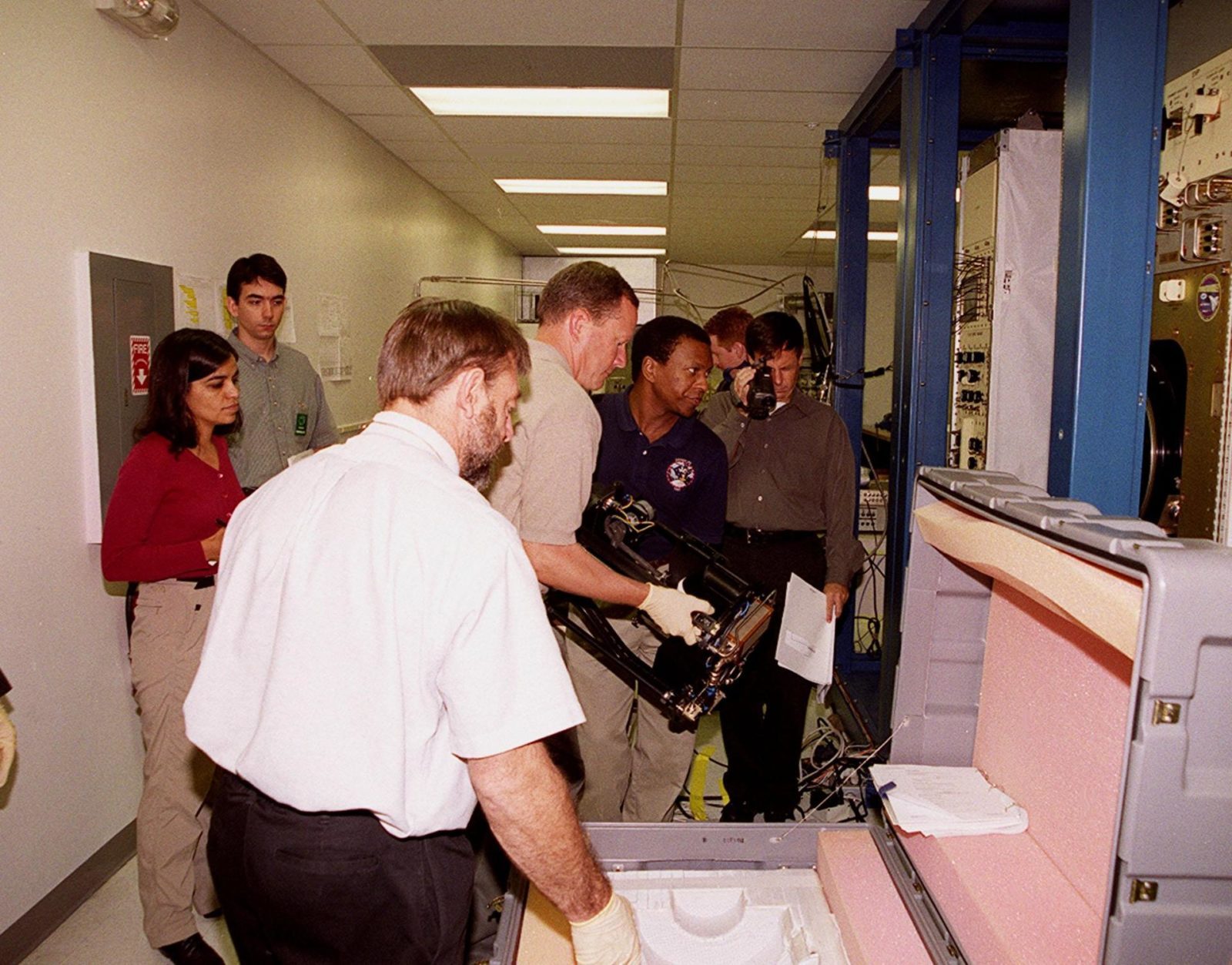 KENNEDY SPACE CENTER, FLA. -- At SPACEHAB, STS-107 crew members check out equipment for their mission. At the far left are Mission Specialists Kalpana Chawla and Ilan Ramon, who is from Israel. At center, handling the equipment, are Mission Specialists David Brown and Michael Anderson. Identified as a research mission, STS-107 is scheduled for launch July 19, 2001 KSC-00pp1593