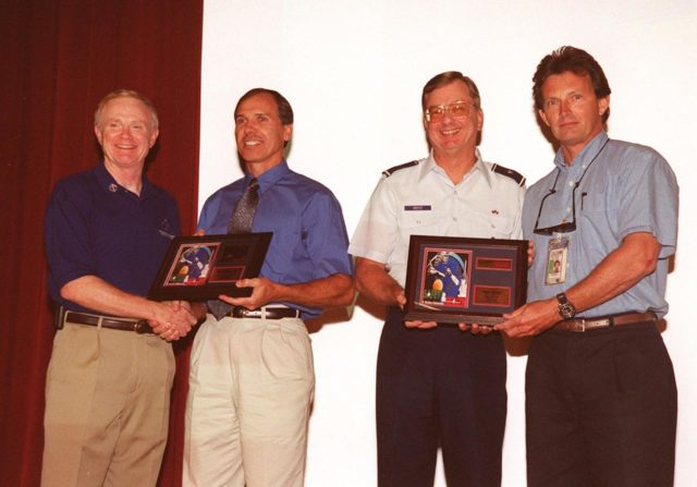 """During Super Safety and Health Day at KSC, two employees were recognized for submitting winning entries in the theme and logo/poster contests. At left, Center Director Roy Bridges congratulates Dave Earhart with United Space Alliance (USA) for his winning logo; at right, Brig. Gen. Ronald D. Pettit congratulates David Koval with Space Gateway Support (SGS) for his winning theme, """"Safety and Health: A Working Relationship."""" Safety Day is a full day of NASA-sponsored, KSC and 45th Space Wing events involving a number of health and safety related activities: Displays, vendors, technical paper sessions, panel discussions, a keynote speaker, etc. The entire Center and Wing stand down to participate in the planned events. Safety Day is held annually to proactively increase awareness in safety and health among the government and contractor workforce population. The first guiding principle at KSC is """"Safety and Health First."""" KSC's number one goal is to """"Assure sound, safe and efficient practices and processes are in place for privatized/commercialized launch site processing. KSC00pp1581"""