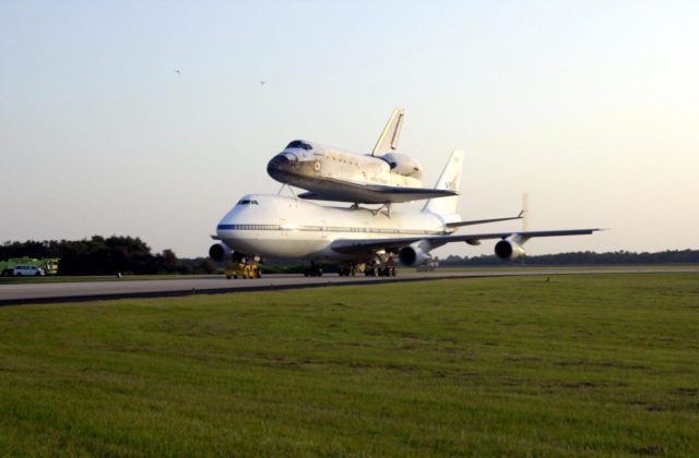 Catching the glow of the late afternoon sun, the Shuttle Carrier Aircraft (SCA) rolls down the runway at the Shuttle Landing Facility as it returns the orbiter Discovery to KSC. The ferry flight started in California after the orbiter's landing more than a week ago at Edwards Air Force Base at the end of mission STS-92. Discovery wears a tail cone protecting its aft nozzles for the ferry flight. Discovery will be demated from the SCA via the mate/demate device at the SLF and transported to the Orbiter Processing Facility bay 1. There it will undergo preparations for its next launch, STS-102, scheduled for February 2001 KSC-00padig080