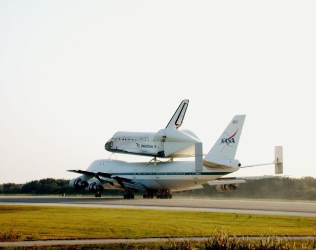 In late afternoon, the Shuttle Carrier Aircraft (SCA) rolls down the runway at the Shuttle Landing Facility as it returns the orbiter Discovery to KSC. The ferry flight started in California where the orbiter landed more than a week ago at Edwards Air Force Base at the end of mission STS-92. Discovery wears a tail cone protecting its aft nozzles for the ferry flight. Discovery will be demated from the SCA via the mate/demate device at the SLF and transported to the Orbiter Processing Facility bay 1. There it will undergo preparations for its next launch, STS-102, scheduled for February 2001 KSC00padig079