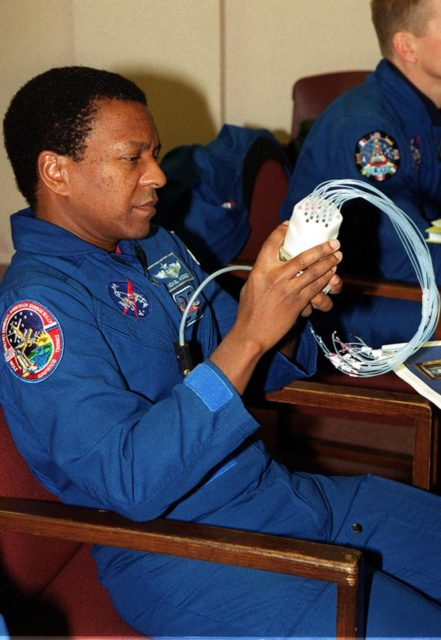 """KENNEDY SPACE CENTER, FLA. -- During In-Flight Maintenance training, STS-107 Mission Specialist Michael Anderson looks over a """"Medusa,"""" a piece of a Biotube experiment that will be on the STS-107 mission. The Medusa is part of a watering system for plants. As a research mission, STS-107 will carry the SPACEHAB Double Module in its first research flight into space and a broad collection of experiments ranging from material science to life science. It is scheduled to launch July 19, 2001 KSC-00pp1850"""
