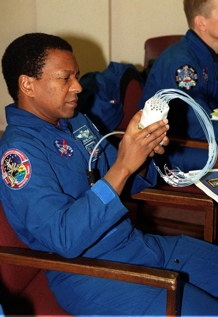 """KENNEDY SPACE CENTER, FLA. -- During In-Flight Maintenance training, STS-107 Mission Specialist Michael Anderson looks over a """"Medusa,"""" a piece of a Biotube experiment that will be on the STS-107 mission. The Medusa is part of a watering system for plants. As a research mission, STS-107 will carry the SPACEHAB Double Module in its first research flight into space and a broad collection of experiments ranging from material science to life science. It is scheduled to launch July 19, 2001 KSC00pp1850"""