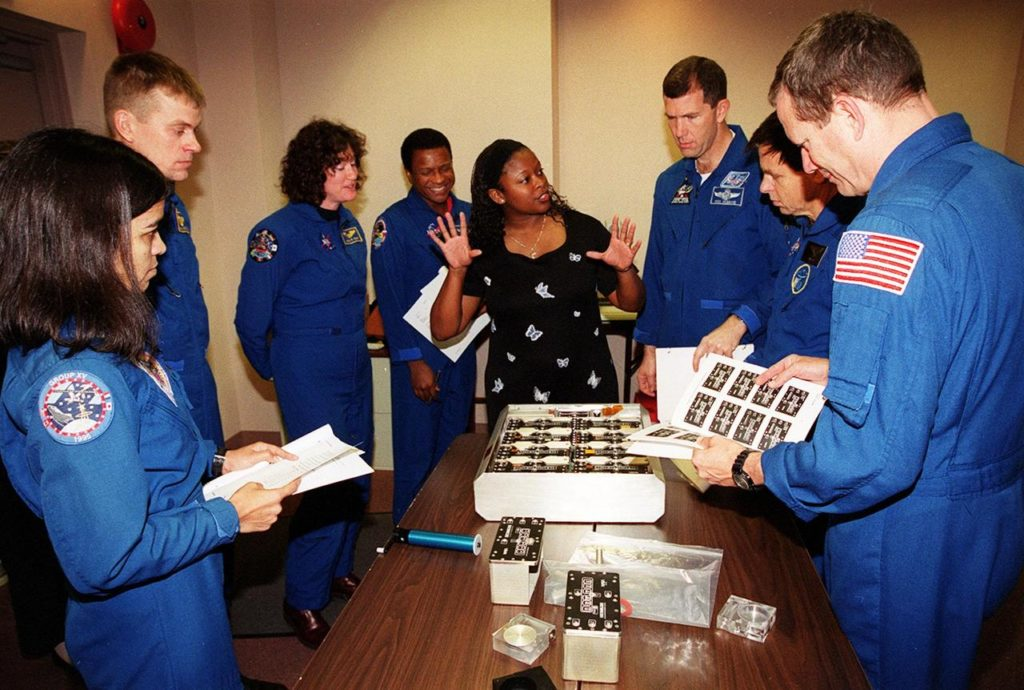 """KENNEDY SPACE CENTER, FLA. -- As part of In-Flight Maintenance training at SPACEHAB, in Cape Canaveral, Fla., members of the STS-107 crew learn about Biological Research in Canisters (BRIC) experiments that will be on their mission. From left are Mission Specialist Kalpana Chawla, Pilot William C. """"Willie"""" McCool, Mission Specialists Laurel Clark and Michael Anderson, Roberteen McCray of Bionetics, Commander Rick D. Husband,; Payload Specialist Ilan Ramon of Israel and Mission Specialist David M. Brown. STS-107 will carry a broad collection of experiments ranging from material science to life science. It is scheduled to launch July 19, 2001 KSC00pp1857"""