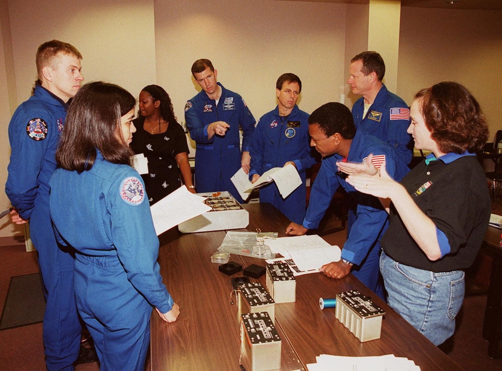 """KENNEDY SPACE CENTER, FLA. -- As part of In-Flight Maintenance training at SPACEHAB, in Cape Canaveral, Fla., the STS-107 crew learns about Biological Research in Canisters (BRIC) experiments that will be on their mission. From left are Mission Specialist Kalpana Chawla, Pilot William C. """"Willie"""" McCool, Roberteen McCray of Bionetics, Commander Rick D. Husband, Payload Specialist Ilan Ramon of Israel, and Mission Specialists David M. Brown and Michael Anderson. At right is Debbie Wells of Bionetics. Not seen is Mission Specialist Laurel Clark. STS-107 will carry a broad collection of experiments ranging from material science to life science. It is scheduled to launch July 19, 2001 KSC00pp1860"""