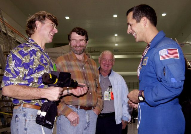 """Astronaut John Herrington (right) shares a humorous moment with Steve Thomas (left) and Norm Abram (second from left), who are seen in the television series """" This Old House."""" In the background is Johnny Johnson, media escort. Abram is at KSC to film an episode of """"This Old House. KSC-00padig126"""