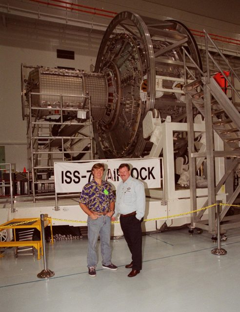 """KENNEDY SPACE CENTER, FLA. --  In the Space Station Processing Facility, Steve Thomas (left), host of the television series """"This Old House,"""" poses in front of the Joint Airlock module. Thomas and Norm Abram, master carpenter with """"This Old House,"""" are at KSC to film an episode of the series KSC-00pp1917"""