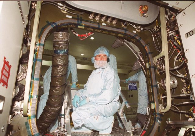 """KENNEDY SPACE CENTER, FLA. --  Steve Thomas, host of the television series """"This Old House,"""" gets a look inside one of the Space Station modules in the Space Station Processing Facility. He and the show's master carpenter Norm Abram are at KSC to film an episode of the series KSC00pp1922"""
