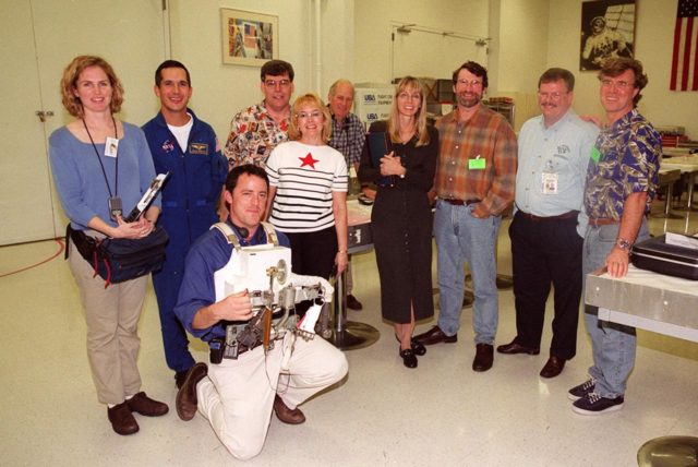 The crew of the television series This Old House pauses for a photo during a tour of KSC. At the far right is Steve Thomas, host of the series. Second from the right is Norm Abram, master carpenter on the show. Accompanying the film crew is astronaut John Herrington (second from left). The cast and crew of This Old House are filming at KSC for an episode of the show KSC00pp1952