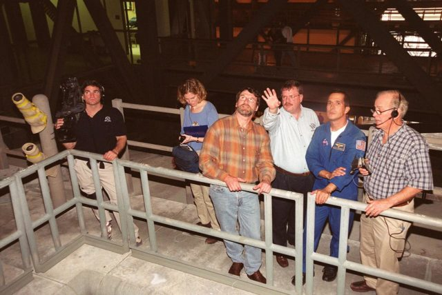 Members of the crew of the television series This Old House get a close look at Space Shuttle Atlantis in the Vehicle Assembly Building. In the center is Norm Abram, master carpenter on the series. Second from the right is astronaut John Herrington, who is accompanying the film crew on their tour of KSC. The cast and crew of This Old House are filming at KSC for an episode of the show KSC00pp1956