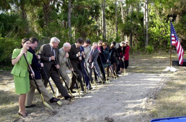 At a groundbreaking ceremony, participants and guests get ready to dig in, signifying the start of construction on a new roadway through KSC. It is the start of a construction project that includes the Space Experiment Research & Processing Laboratory (SERPL). From left are Dr. Pamella J. Dana, from the executive office of Florida's governor, Jeb Bush; Deputy Associate Administrator Michael Hawes, Space Station, NASA; Sen. George Kirkpatrick; Spaceport Florida Authority Executive Director Ed Gormel; Executive Director Dr. Samuel T. Durrance, Florida Space Research Institute; Florida's Lt. Gov. Frank Brogan; Congressman Dave Weldon; Center Director Roy Bridges Jr.; SFA SERPL Program Manager Debra Holliday; KSC SERPL Program Manager Jan Heuser; District Manager Cheryl Harrison-Lee, Florida Department of Transportation; State Senator Jim Sebesta; and KSC Director JoAnn H. Morgan, External Relations and Business Development. The project is enabled by a partnership and collaboration between NASA and the State of Florida to create a vital resource for international and commercial space customers. SERPL is considered a magnet facility, and will support the development and processing of life sciences experiments destined for the International Space Station and accommodate NASA, industry and academic researchers performing associated biological research KSC01padig064