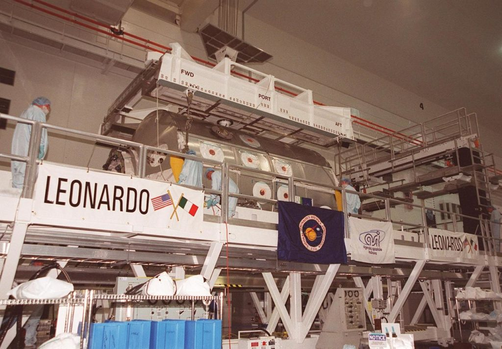 In the Space Station Processing Facility, workers attach an overhead crane to the Multi-Purpose Logistics Module Leonardo. The MPLM is being moved to the payload canister for transfer to Launch Pad 39B and installation in Space Shuttle Discovery. The Leonardo, one of Italy's major contributions to the International Space Station program, is a reusable logistics carrier. It is the primary delivery system used to resupply and return Station cargo requiring a pressurized environment. Leonardo is the primary payload on mission STS-102 and will deliver up to 10 tons of laboratory racks filled with equipment, experiments and supplies for outfitting the newly installed U.S. Laboratory Destiny. STS-102 is scheduled to launch March 8 at 6:45 a.m. EST KSC-01pp0352