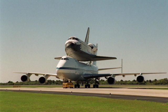 At the Shuttle Landing Facility, the Shuttle Carrier Aircraft, with the orbiter Atlantis on top, is towed around the turn to to the parking area at the Shuttle Landing Facility. There it will be demated from the orbiter in the mate/demate device. Atlantis landed in California Feb. 19 concluding mission STS-98. The ferry flight began in California March 1; unfavorable weather conditions kept it on the ground at Altus AFB, Okla., until it could return to Florida. The orbiter will next fly on mission STS-104, the 10th construction flight to the International Space Station, scheduled June 8 KSC-01pp0496