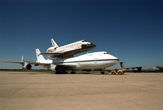 The Shuttle Carrier Aircraft, with its piggyback cargo the orbiter Atlantis, is towed to the parking area at the Shuttle Landing Facility. There it will be demated from the orbiter in the mate/demate device. Atlantis landed in California Feb. 19 concluding mission STS-98. The ferry flight began in California March 1; unfavorable weather conditions kept it on the ground at Altus AFB, Okla., until it could return to Florida. The orbiter will next fly on mission STS-104, the 10th construction flight to the International Space Station, scheduled June 8 KSC-01pp0497