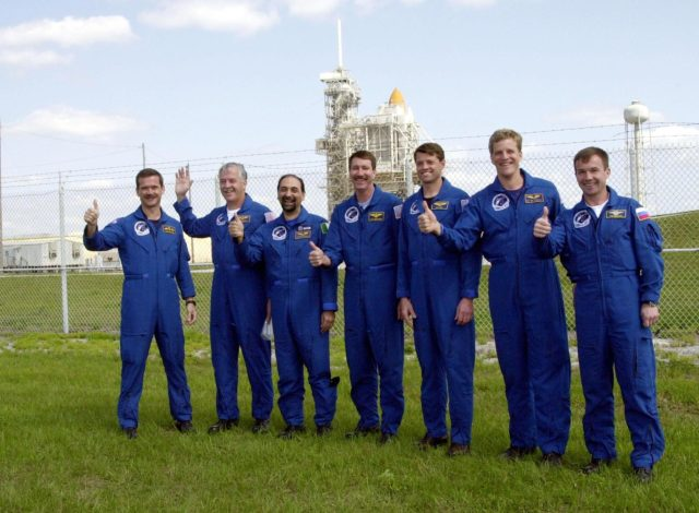 KENNEDY SPACE CENTER, FLA. -- The STS-100 crew gives thumbs up on launch as they gather near Launch Pad 39A to greet family and friends. Starting at left, they are Mission Specialists Chris A. Hadfield, John L. Phillips and Umberto Guidoni; Commander Kent V. Rominger; Pilot Jeffrey S. Ashby; and Mission Specialists Scott E. Parazynski and Yuri V. Lonchakov. Hadfield is with the Canadian Space Agency; Guidoni is with the European Space Agency; and Lonchakov is with the Russian Aviation and Space Agency. In the background on the pad can be seen the tips of Space Shuttle Endeavour's orange external tank and white solid rocket boosters. The 80-foot lightning rod towers above the Shuttle and service structures. The crew is at KSC to complete final flight plan reviews in anticipation of launch. The 11-day mission to the International Space Station will deliver and integrate the Spacelab Logistics Pallet/Launch Deployment Assembly, which includes the Space Station Remote Manipulator system and the UHF Antenna, and the Multi-Purpose Logistics Module Raffaello. The mission includes two planned spacewalks for installation of the SSRMS. The mission is also the inaugural flight of the MPLM Raffaello, carrying resupply stowage racks and resupply/return stowage platforms. Liftoff on mission STS-100 is scheduled at 2:41 p.m. EDT April 19 KSC01padig198