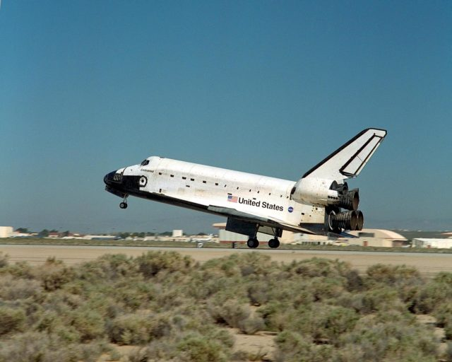 NASA/EDWARDS AFB, CALIF. -- Endeavour's rear wheels touch down on runway 22 at Edwards Air Force Base, Calif., after the 11-day, 12-hour, 54-minute mission STS-100 to the International Space Station. Landing time was 12:10:42 p.m. EDT. The orbiter and its crew of seven logged about 4.9 million statute miles in 186 orbits. Due to unfavorable weather conditions, landing at KSC was waved off. The landing marked the third consecutive landing at EAFB. KSC-01PP0949