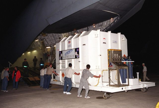 KENNEDY SPACE CENTER, Fla. -- Workers off-load NASA's Genesis spacecraft which arrived at the Shuttle Landing Facility at 3:30 a.m. aboard an Air Force C-17 aircraft.; Lockheed Martin Astronautics built the Genesis spacecraft for NASA in Denver, Colo.; The spacecraft will undergo final launch preparations in the Payload Hazardous Servicing Facility in KSC's industrial area. Genesis will capture samples of the ions and elements in the solar wind and return them to Earth for scientists to use to determine the exact composition of the Sun and the solar system's origin. Launch aboard a Boeing Delta II rocket is scheduled for July 30 at 12:36 p.m. EDT.; NASA's Genesis project in managed by the Jet Propulsion Laboratory in Pasadena, Calif KSC-01pp1049