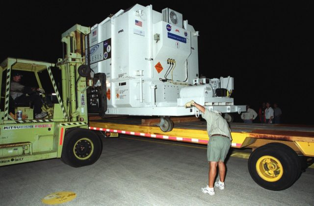 KENNEDY SPACE CENTER, Fla. -- At the Shuttle Landing Facility, workers prepare NASA's Genesis spacecraft for transport to the Payload Hazardous Servicing Facility in KSC's industrial area where it will undergo final preparations;for launch.; The spacecraft arrived aboard an Air Force C-17 aircraft from Denver, Colo., where it was built for NASA by Lockheed Martin Astronautics.; Genesis is designed to capture samples of the ions and elements in the solar wind and return them to Earth for scientists to use to determine the exact composition of the Sun and the solar system's origin. Launch aboard a Boeing Delta II rocket is scheduled for July 30 at 12:36 p.m. EDT.; NASA's Genesis project in managed by the Jet Propulsion Laboratory in Pasadena, Calif KSC-01pp1050