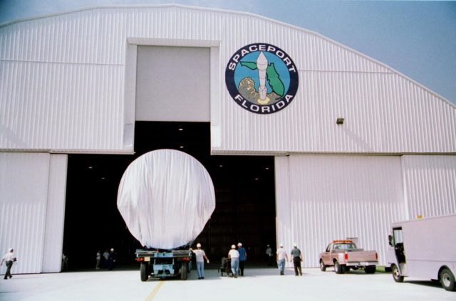 KENNEDY SPACE CENTER, Fla. -- The P5 truss rolls into the Spaceport Florida hangar just before a rain storm. The truss eventually will be transported to the Space Station Processing Facility. The P5 is scheduled for delivery to the International Space Station on mission 12A.1 in April 2003 KSC-01pp1362