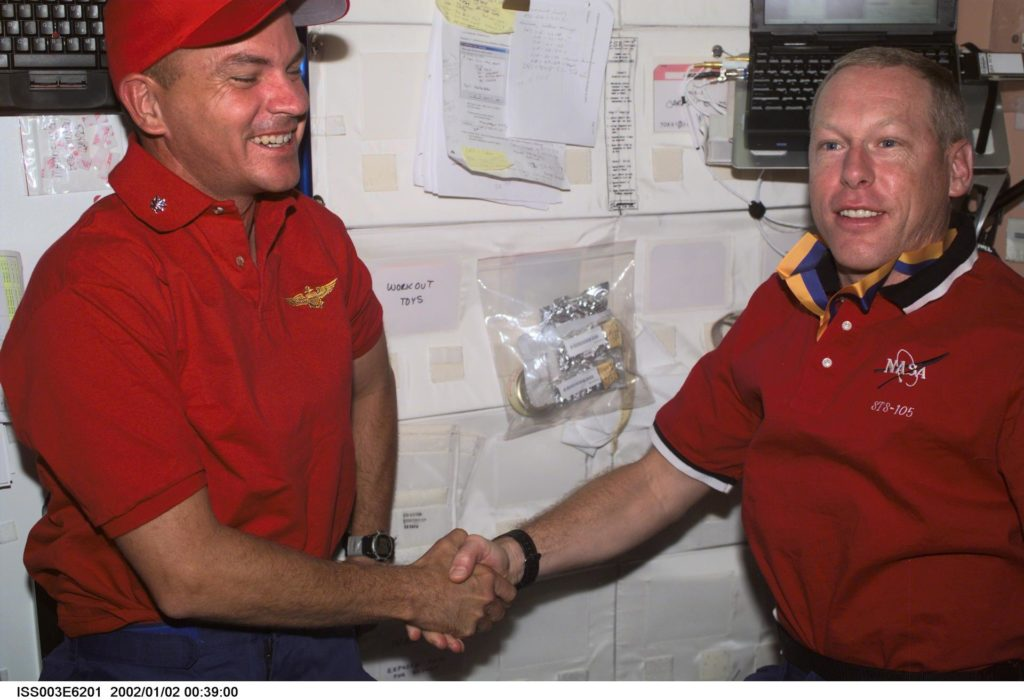 Sturckow is presented with a military award by Forrester in Node 1