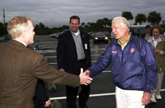 KENNEDY SPACE CENTER, FLA. --  Center Director Roy D. Bridges Jr. (left) welcomes former President Jimmy Carter to Kennedy Space Center.  Behind Carter, at right, is Rosalyn Carter, his wife.  The Carters are touring KSC KSC-02pd0001