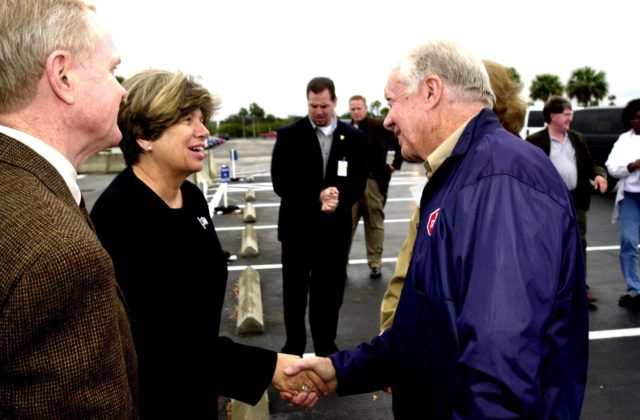 KENNEDY SPACE CENTER, FLA. --  Director of External Affairs and Business Development JoAnn H. Morgan greets former President Jimmy Carter on his visit to Kennedy Space Center.  At far left is Center Director Roy D. Bridges Jr.  Carter and former First Lady Rosalyn Carter are touring KSC KSC-02pd0002