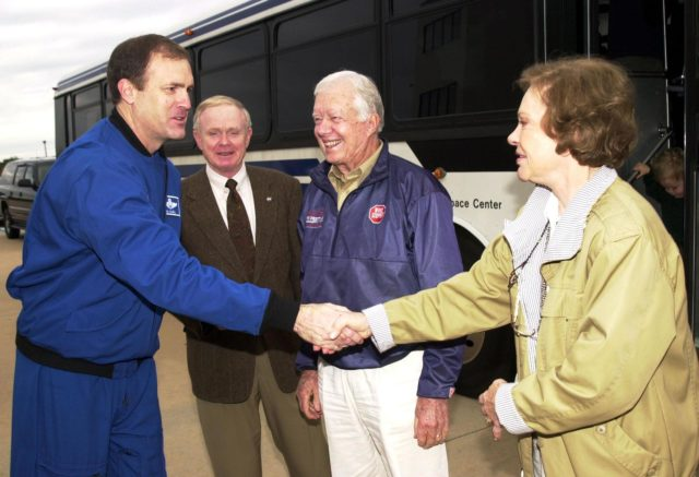 KENNEDY SPACE CENTER, FLA. -- During a visit to Kennedy Space Center, James Halsell (far left), manager, Launch Integration, Space Shuttle Program, greets former First Lady Rosalyn Carter (far right).  Looking on are Center Director Roy D. Bridges Jr. (left) and former President Jimmy Carter (right).  The Carters are touring KSC KSC-02pd0007