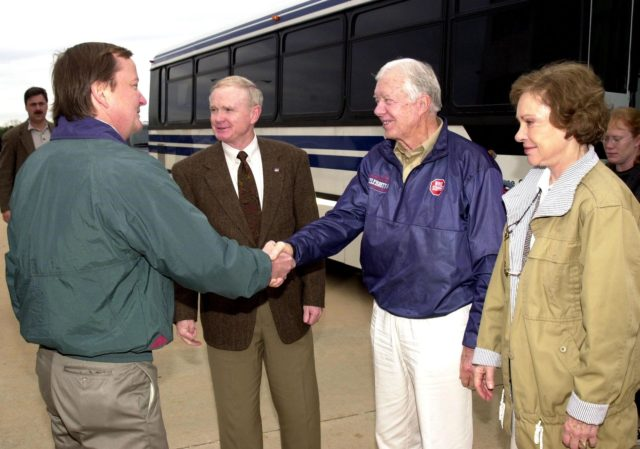 KENNEDY SPACE CENTER, FLA. - Launch Director Mike Leinbach greets former President Jimmy Carter , who is touring Kennedy Space Center with his wife Rosalyn (right).  Center Director Roy D. Bridges Jr. stands between Leinbach and Carter KSC-02pd0008
