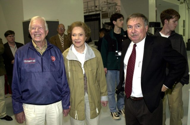 KENNEDY SPACE CENTER, FLA. --  Former President Jimmy Carter (left) and Rosalyn Carter visit the Space Station Processing Facility on their tour of Kennedy Space Center.  With them (right) is Director of Payload Processing, International Space Station, Tip Talone (left of Rosalyn Carter) KSC-02pd0010