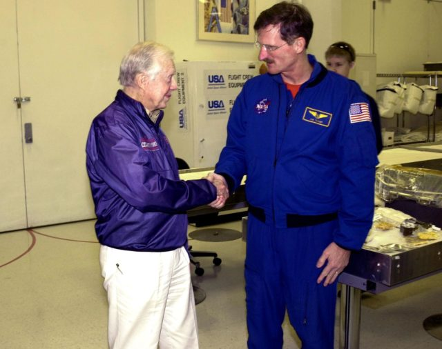 KENNEDY SPACE CENTER, FLA. --  Former President Jimmy Carter shakes the hand of astronaut Joseph Tanner. Carter and former First Lady Rosalyn Carter are touring KSC KSC-02pd0015
