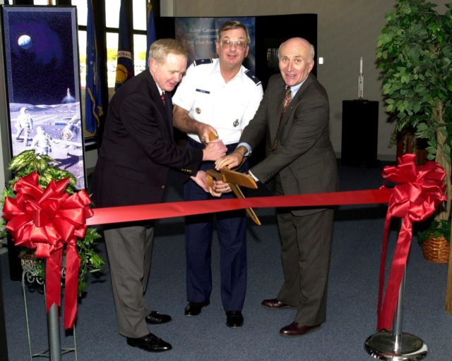 KENNEDY SPACE CENTER, FLA. --   (From left) Center Director Roy Bridges, Brig. Gen. Donald P. Pettit  and Executive Director of the Cape Canaveral Spaceport Management Office Ed Gormel share the ribbon cutting at the formal opening of a Customer Service office at the Spaceport.  Gen. Pettit is the commander of the 45th Space Wing KSC-02pd0041