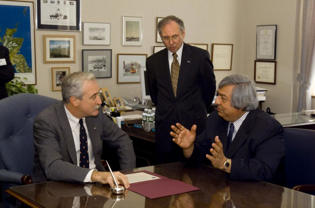 NASA Administrator Sean O'Keefe comes to Ames for employee briefing and tour. Meets with Roberto Cruz, National Hispanic University (seated, right) and Ames Center Director Dr. Henry McDonald follow the signing of the educational MOU between NHU and Ames. ARC-2002-ACD02-0015-078