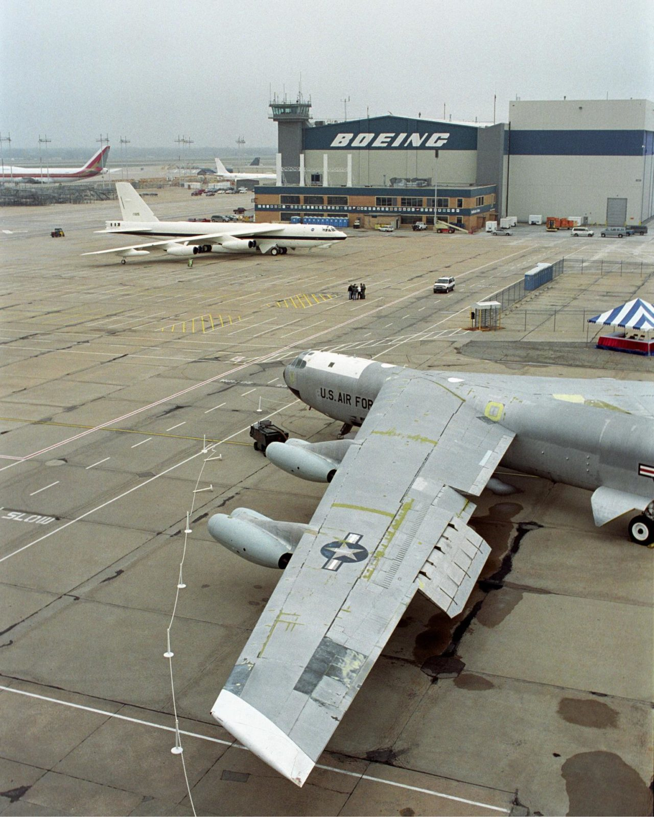 NASA's veteran silver B-52B, foreground, joined the new B-52H in NASA markings for a ceremony in Wichita, Kansas, April 12, 2002, marking the 50th anniversary of the B-52 aircraft EC02-0080-38