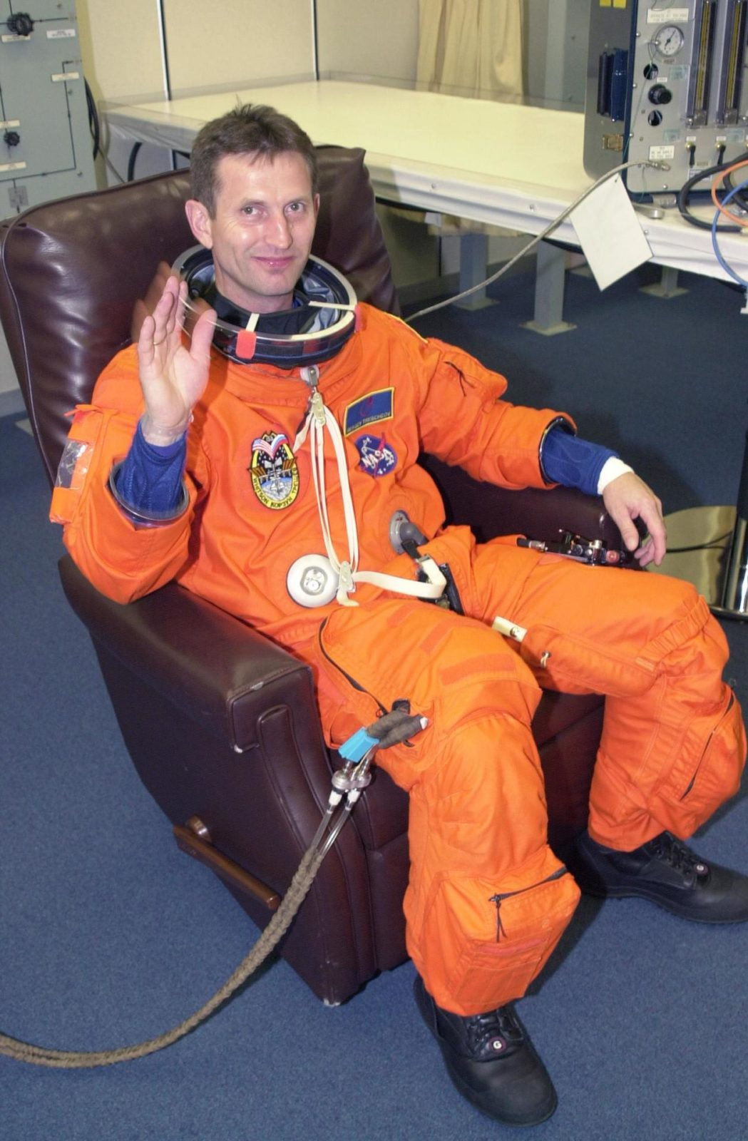 KENNEDY SPACE CENTER, FLA. --  Expedition 5 cosmonaut Sergei Treschev (RSA) waves as he dons his launch and entry suit for the scheduled liftoff of Space Shuttle Endeavour at 7:44 p.m. EDT.  This is Treschev's first Shuttle flight.  Expedition 5 is traveling on mission STS-111 to the International Space Station to replace the current resident crew, Expedition 4.  STS-111 is the second Utilization Flight to the International Space Station, carrying the Multi-Purpose Logistics Module Leonardo, the Mobile Base System (MBS), and a replacement wrist/roll joint for the Canadarm 2. The MBS will be installed on the Mobile Transporter to complete the Canadian Mobile Servicing System, or MSS. Expedition 4 crew members will return to Earth with the STS-111 crew on Endeavour. KSC-02pd0831