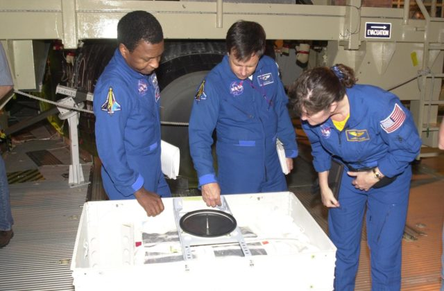 KENNEDY SPACE CENTER, FLA. -- During Crew Equipment Interface Test activities, the STS-107 crew looks at flight equipment in the Orbiter Processing Facility.  From left are Payload Commander Michael Anderson, Payload Specialist Ilan Ramon (with the Israeli Space Agency), and Mission Specialist Laurel Clark. STS-107 is a research mission, with the SHI Research Double Module (SHI/RDM), also known as SPACEHAB, as the primary payload, plus the Fast Reaction Experiments Enabling Science, Technology, Applications and Research (FREESTAR) that incorporates eight high priority secondary attached shuttle experiments.  STS-107 is scheduled to launch July 19, 2002 KSC-02pd0931