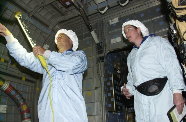 KENNEDY SPACE CENTER, FLA. - STS-107 Mission Specialists Ilan Ramon, with the Israeli Space Agency, and Laurel Clark check out equipment in the SHI Research Double Module (SHI/RDM), part of the payload on the mission.  They are taking part in Crew Equipment Interface Test activities, which include equipment and payload familiarization.  A research mission, STS-107 also will carry the Fast Reaction Experiments Enabling Science, Technology, Applications and Research (FREESTAR) that incorporates eight high priority secondary attached shuttle experiments.  STS-107 is scheduled to launch July 19, 2002 KSC-02pd0941
