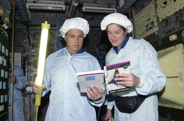 KENNEDY SPACE CENTER, FLA. -- STS-107 Mission Specialists Ilan Ramon, with the Israeli Space Agency, holds a light wand while he and Laurel Clark check out data for equipment in the SHI Research Double Module (SHI/RDM), part of the payload on the mission.  They are taking part in Crew Equipment Interface Test activities, which include equipment and payload familiarization.  A research mission, STS-107 also will carry the Fast Reaction Experiments Enabling Science, Technology, Applications and Research (FREESTAR) that incorporates eight high priority secondary attached shuttle experiments.  STS-107 is scheduled to launch July 19, 2002 KSC-02pd0942