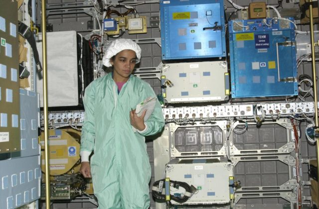 KENNEDY SPACE CENTER, FLA. - STS-107 Mission Specialist Kalpana Chawla looks at equipment inside the SHI Research Double Module (SHI/RDM), part of the payload on the mission. The crew is taking part in Crew Equipment Interface Test activities, which include equipment and payload familiarization. A research mission, STS-107 also will carry the Fast Reaction Experiments Enabling Science, Technology, Applications and Research (FREESTAR) that incorporates eight high priority secondary attached shuttle experiments.  STS-107 is scheduled to launch July 19, 2002 KSC-02pd0948