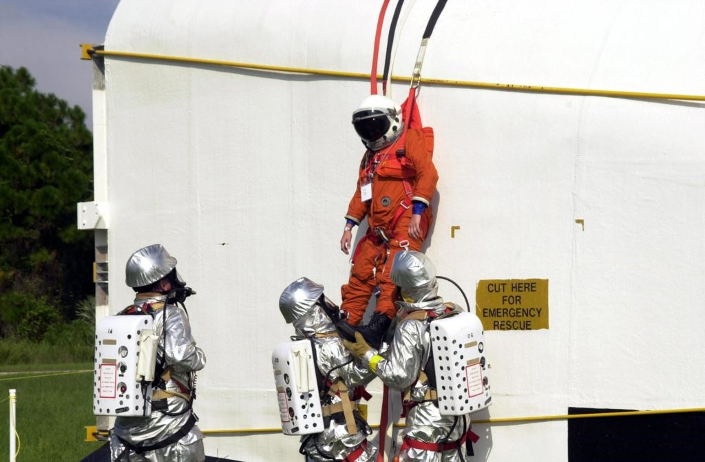 """KENNEDY SPACE CENTER, FLA. - """"Astronauts"""" were safely and successfully recovered from a """"downed"""" Space Shuttle in a Mode VII contingency simulation led by Don Hammel, NASA Landing and Recovery Director. KSC Fire/Rescue and Emergency Medical workers, along with Johnson Space Center and Patrick Air Force Base personnel, participated in the drill. Mode simulations are held periodically at KSC to ensure contingency response forces are well prepared to respond to a wide variety of potential emergency situations. KSC-02pd1252"""