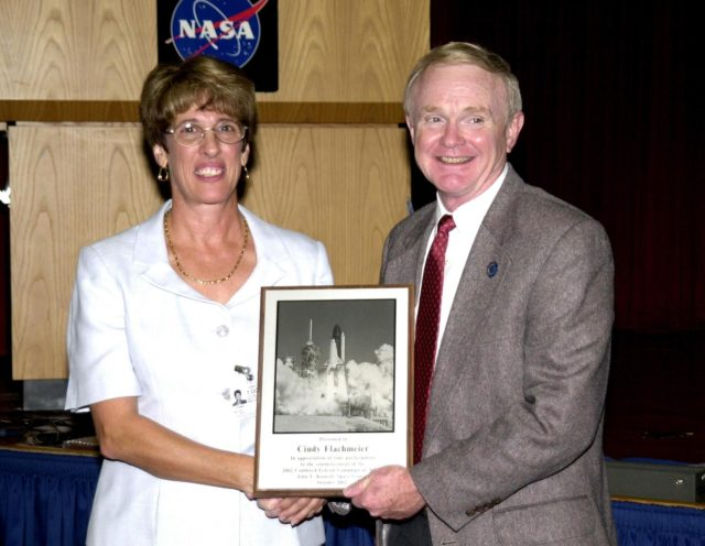 "KENNEDY SPACE CENTER, FLA. - During Kennedy Space Center's  2002 Combined Federal Campaign kickoff rally at the Training Auditorium, Oct. 1, 2002, Center Director, Roy D. Bridges Jr., presented guest speaker Cindy Flachmeier, program coordinator, Domestic Violence Program, Salvation Army of North/Central Brevard, with an appreciation plaque. The CFC is NASA's agencywide annual fundraising campaign for approved worthy causes that runs through Oct. 31, 2002. This year's slogan is ""Promoting Hope…through Generosity."" KSC-02pd1413"