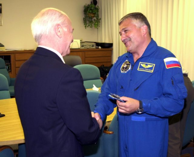KENNEDY SPACE CENTER, FLA. - Aslan Abashidze, President of the Autonomous Republic of Ajara in Georgia (Russia) shakes hands with STS-112 Mission Specialist Fyodor N. Yurchikhin, Ph.D., (right) a cosmonaut with the Russian Space Agency.  Yurchikhin is at Kennedy Space Center awaiting his launch aboard Space Shuttle Atlantis on mission STS-112 to the International Space Station.  The launch has been postponed to no earlier than Monday, Oct. 7, so that the Mission Control Center, located at the Lyndon B. Johnson Space Center in Houston, Texas, can be secured and protected from potential storm impacts from Hurricane Lili. KSC-02pd1429