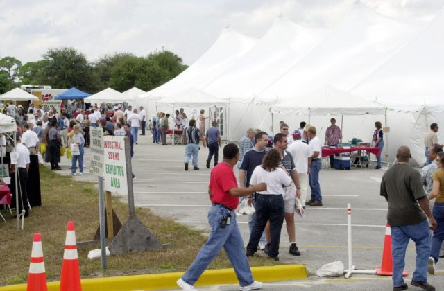KENNEDY SPACE CENTER, FLA. --  KSC employees stroll an exhibit area, under tents, during Spaceport Super Safety & Health Day.  Dozens of presentations and exhibits across the Center focused attention on safety at work and home. KSC-02pd1650