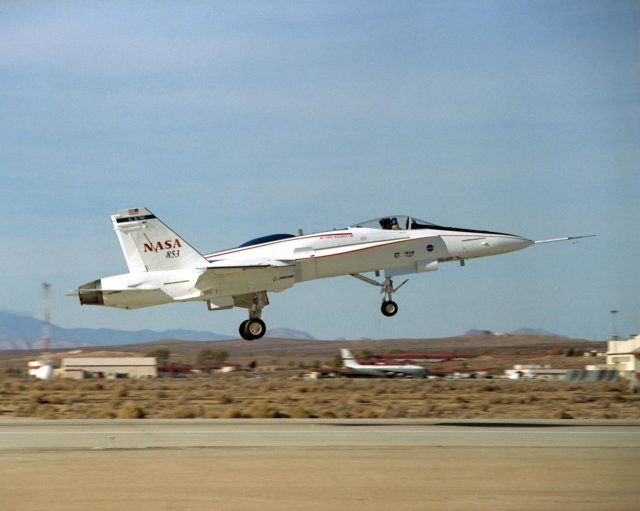 The Active Aeroelastic Wing F-18A lifts off on its first checkout flight November 15, 2002, from NASA's Dryden Flight Research Center at Edwards Air Force Base, Calif. The checkout flight initiated a two-phase NASA--Air Force flight research program that will investigate the potential of aerodynamically twisting flexible wings to improve maneuverability of high-performance aircraft at transonic and supersonic speeds. EC02-0264-01