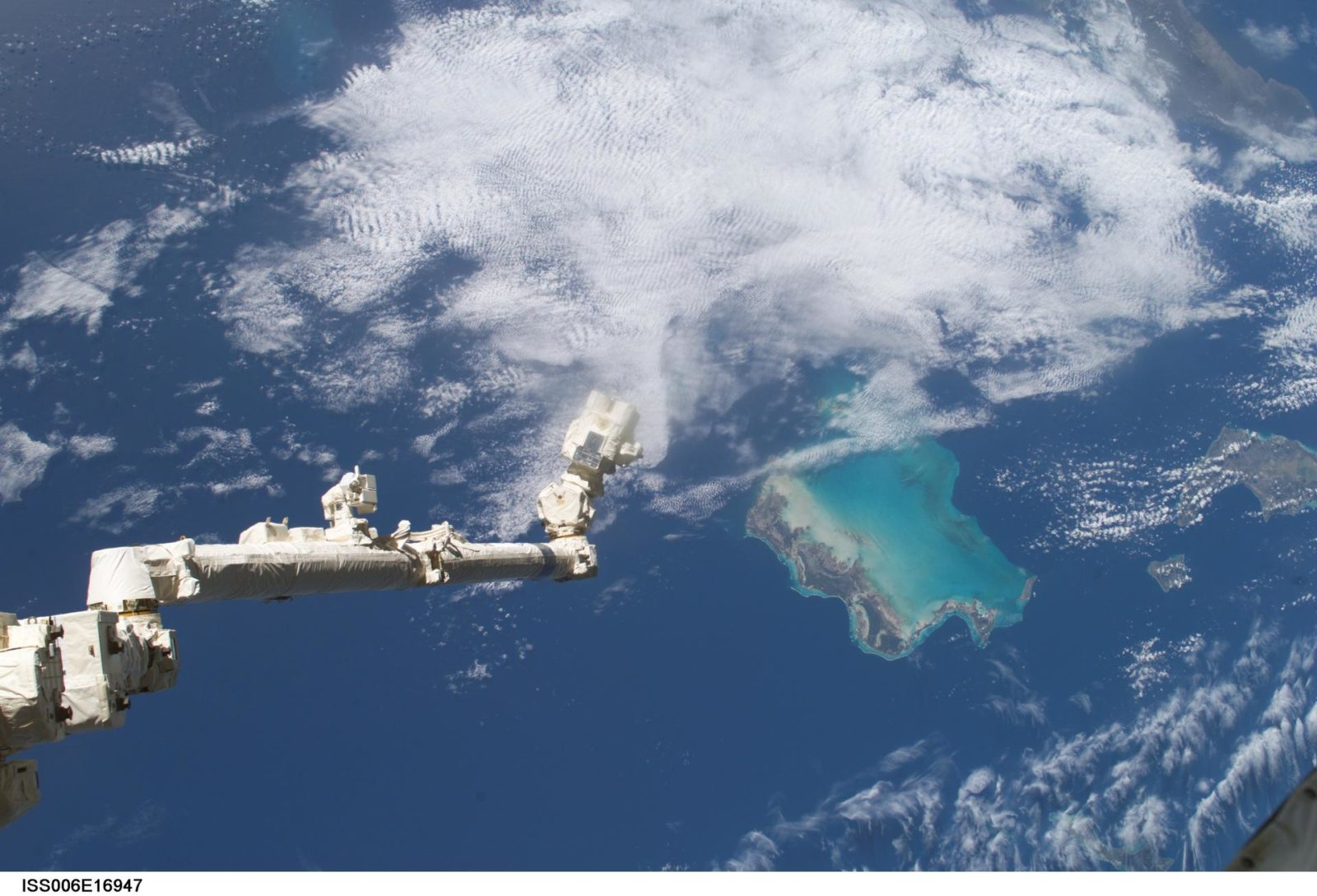 View of the extended SSRMS or Canadarm2 with cloudy view in the background