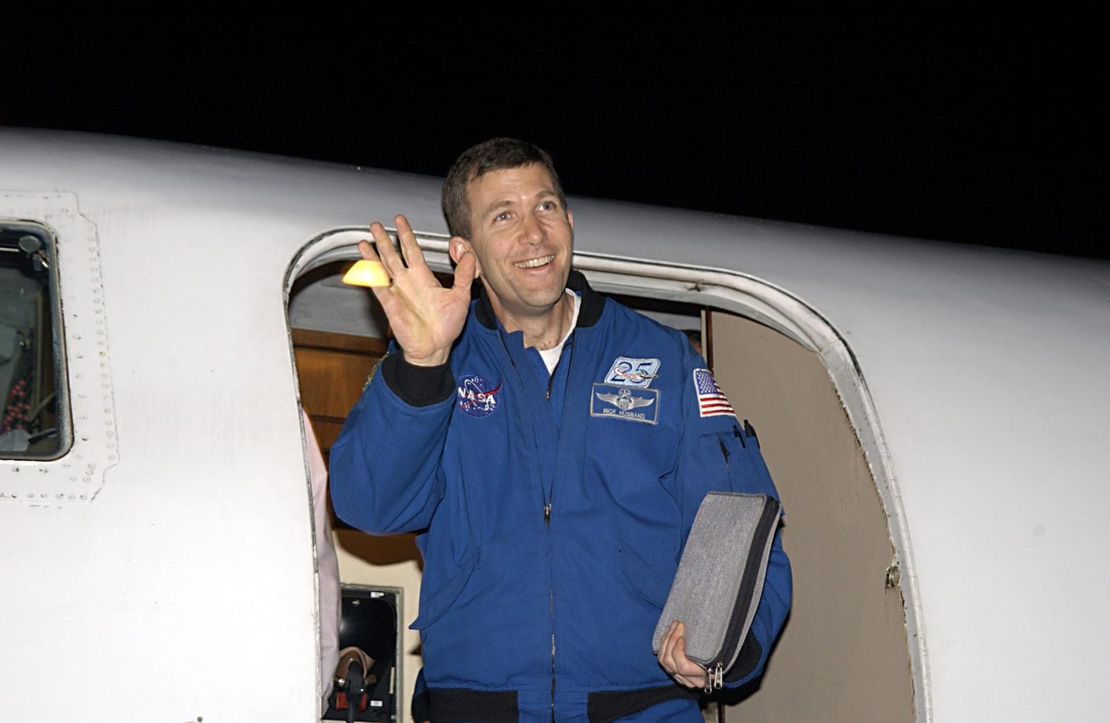 """KENNEDY SPACE CENTER, FLA. - STS-107 Commander Rick Husband waves to spectators as he arrives at KSC for pre-launch preparations. STS-107 is a mission devoted to research and will include more than 80 experiments that will study Earth and space science, advanced technology development, and astronaut health and safety. The payload on Space Shuttle Columbia includes FREESTAR (Fast Reaction Experiments Enabling Science, Technology, Applications and Research) and the SHI Research Double Module (SHI/RDM), known as SPACEHAB.  Experiments on the module range from material sciences to life sciences.  The crew includes Payload Specialist Ilan Ramon, the first Israeli astronaut.  Other crew members are Pilot William """"Willie"""" McCool, Payload Commander Michael Anderson and Mission Specialists Kalpana Chawla, David Brown and Laurel Clark.  Launch of Columbia is targeted for Jan. 16 between 10 a.m. and 2 p.m. KSC-03pd0046"""